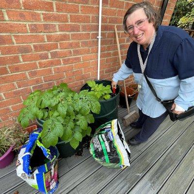 Julie planting potatoes